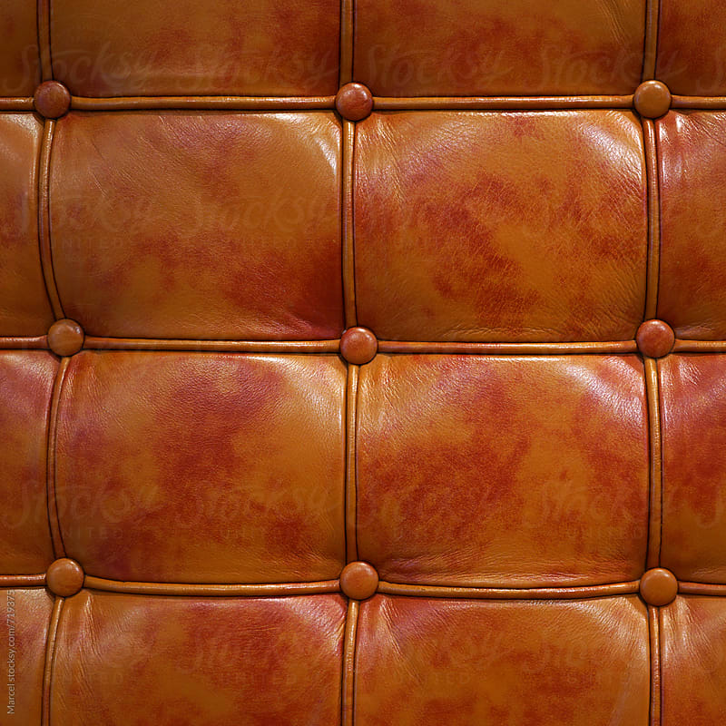 detail of leather chair by Marcel for Stocksy United