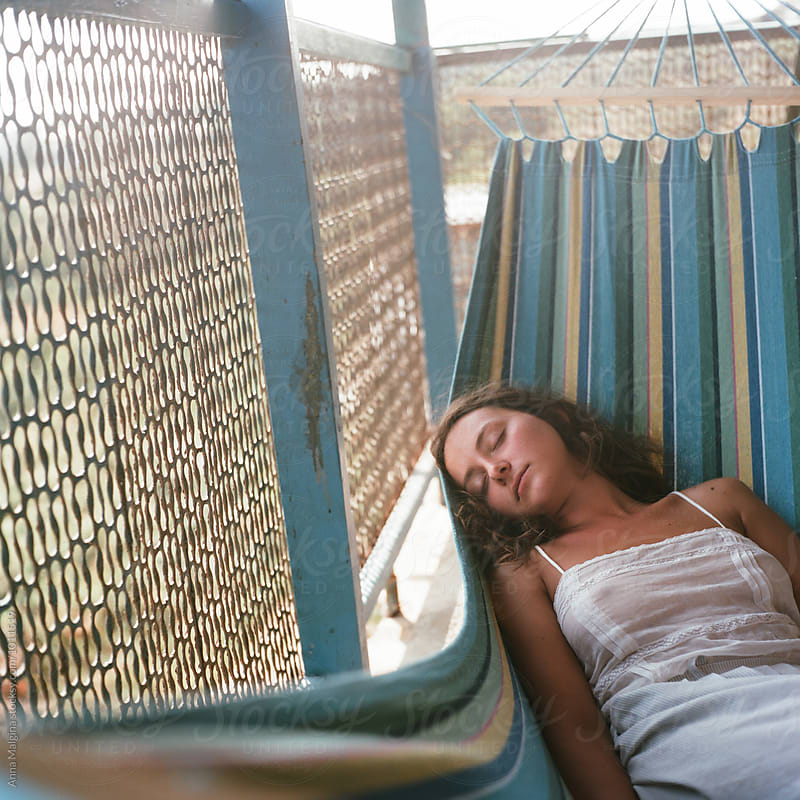 A beautiful woman sleeping in hammock by Anna Malgina for Stocksy United