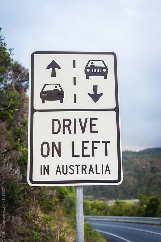 road sign for drive on the left in Australia by Gillian Vann for Stocksy United