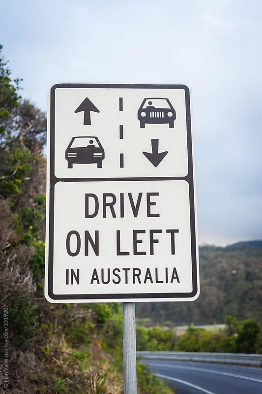 road sign for drive on the left in Australia by Gillian Vann for Stocksy United