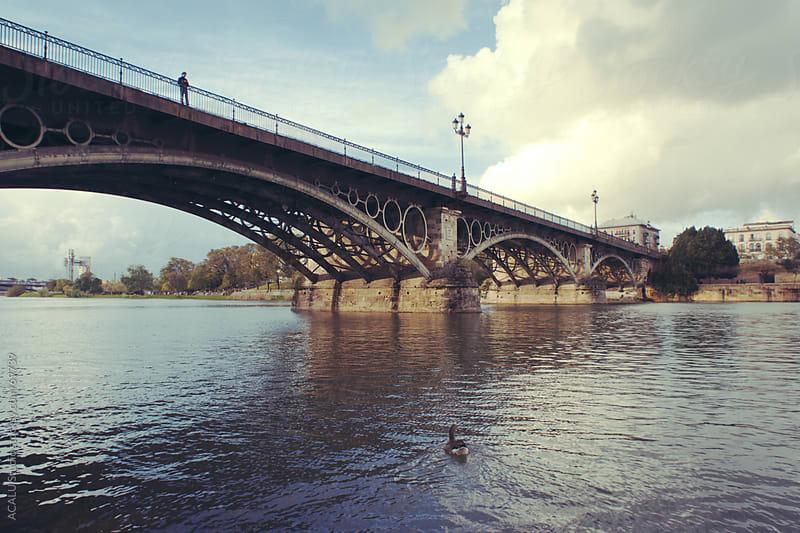 Triana bridge over the Guadalquivir river in Seville by ACALU Studio for Stocksy United