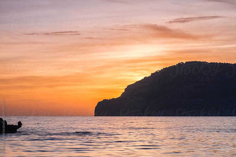 Silhouette of the Majorca coast at sunset by Marilar Irastorza for Stocksy United