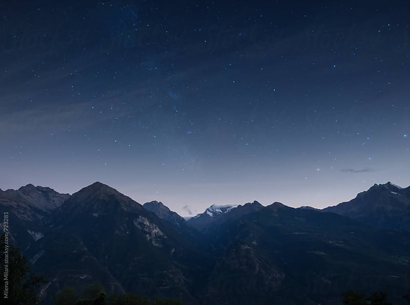 Mountains at night by Milena Milani for Stocksy United