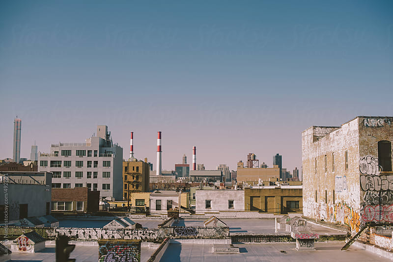 Rooftop view and buildings with graffiti in Queens by Lauren Naefe for Stocksy United