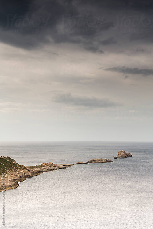Storm is coming over small islands of the coast of Mallorca by Marilar Irastorza for Stocksy United