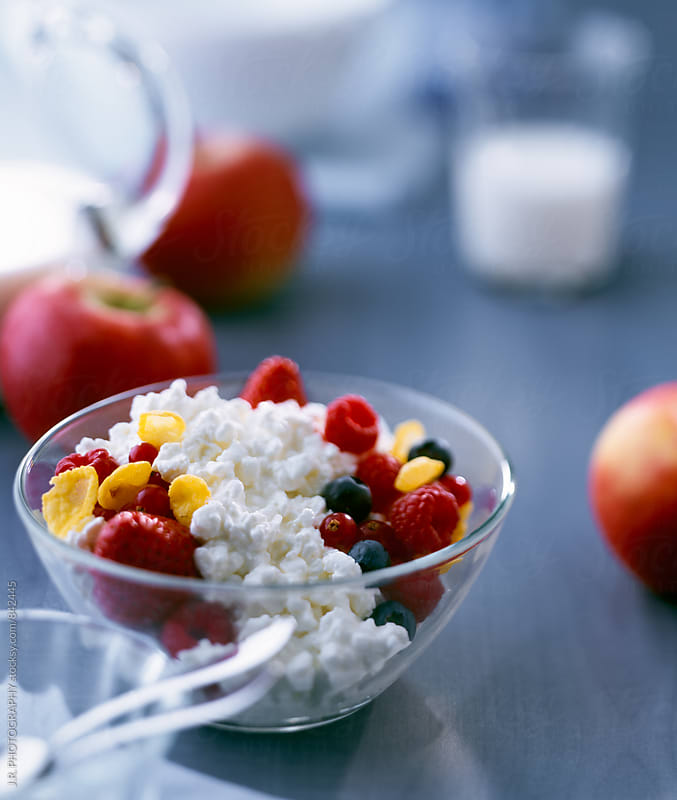 Cottage cheese and berries in a bowl by J.R. PHOTOGRAPHY for Stocksy United