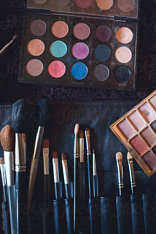 A palette of colourful eye shadows and brushes by Natalie JEFFCOTT for Stocksy United