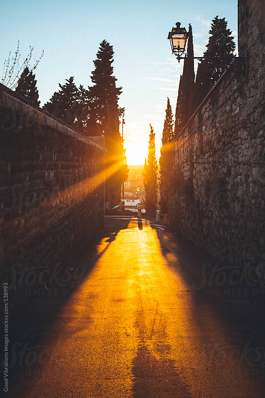Sunset in the alley by Good Vibrations Images for Stocksy United
