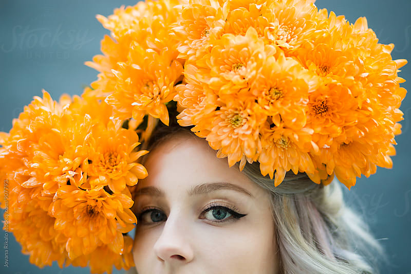 Portrait of a young woman wearing floral hat by Jovana Rikalo for Stocksy United