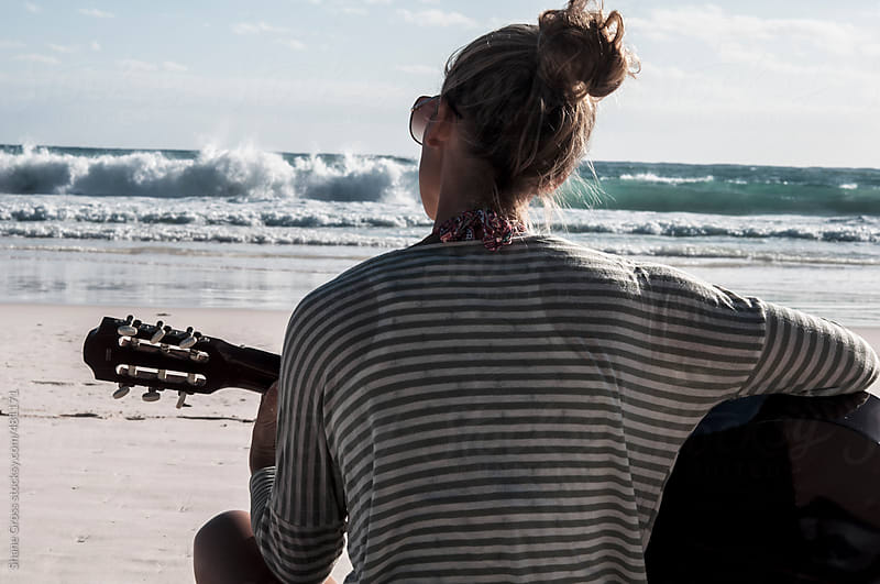 Playing Guitar on the Beach by Shane Gross for Stocksy United
