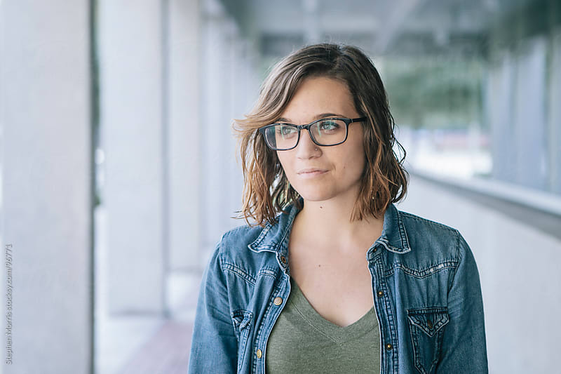 Portrait of Young Woman Wearing Glasses by Stephen Morris for Stocksy United