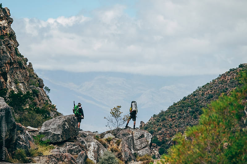 Hikers on a rocky outcrop in the mountains enjoying the view by Micky Wiswedel for Stocksy United
