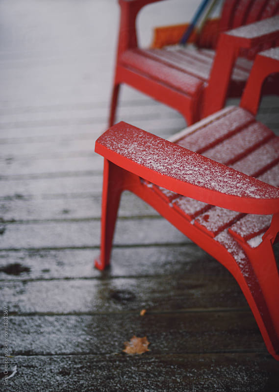 Snow On Red Chairs by Tina Crespo for Stocksy United
