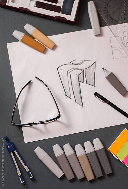 A drawing and markers on the desk by Aleksandra Jankovic for Stocksy United