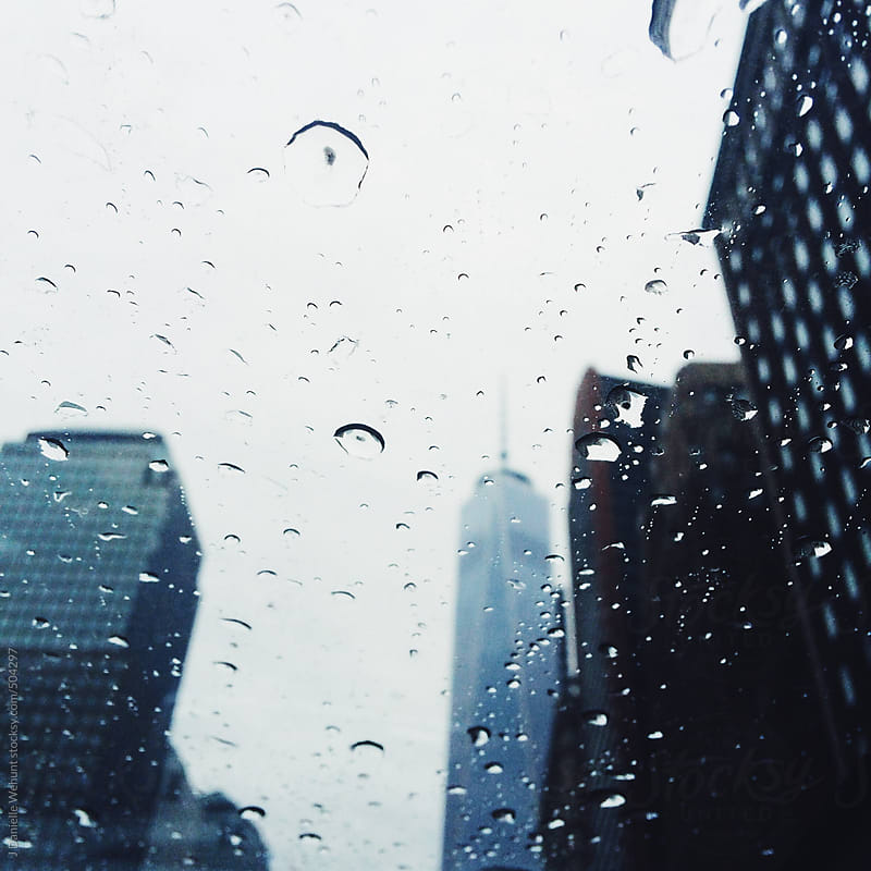 A view of the World Trade Building through a sun roof on a rainy day. by J Danielle Wehunt for Stocksy United