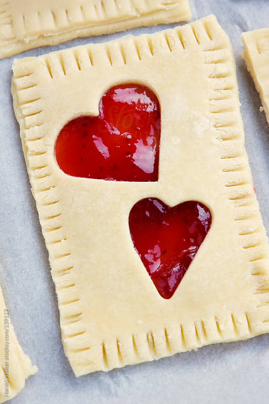 Making toaster pastries for Valentine's Day by Harald Walker for Stocksy United