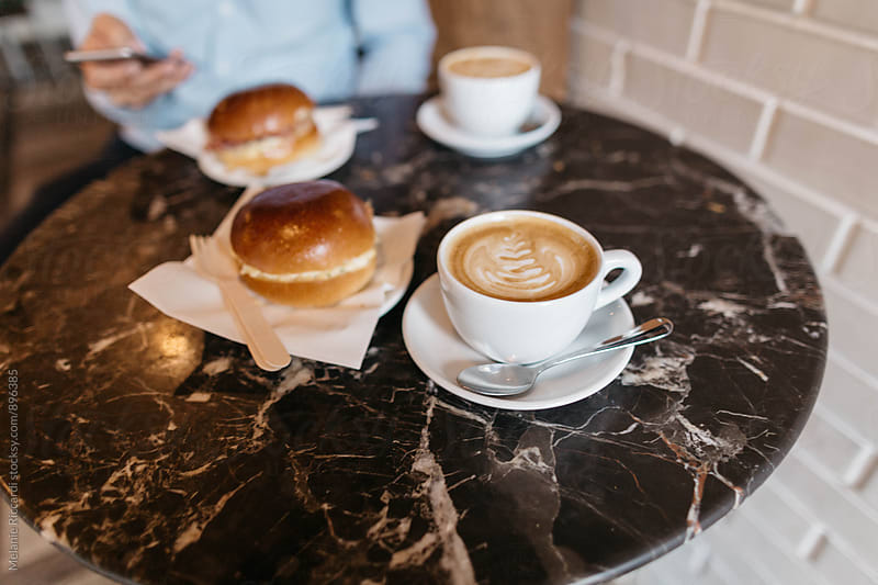 Cappuccino in a coffee shop by Melanie Riccardi for Stocksy United