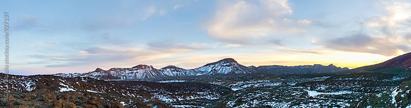 Panorama from snowy mountains at sunset by ACALU Studio for Stocksy United