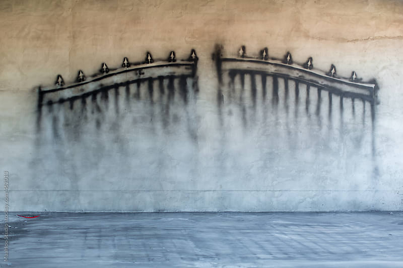 Wall with a gate painting on it by MaaHoo Studio for Stocksy United