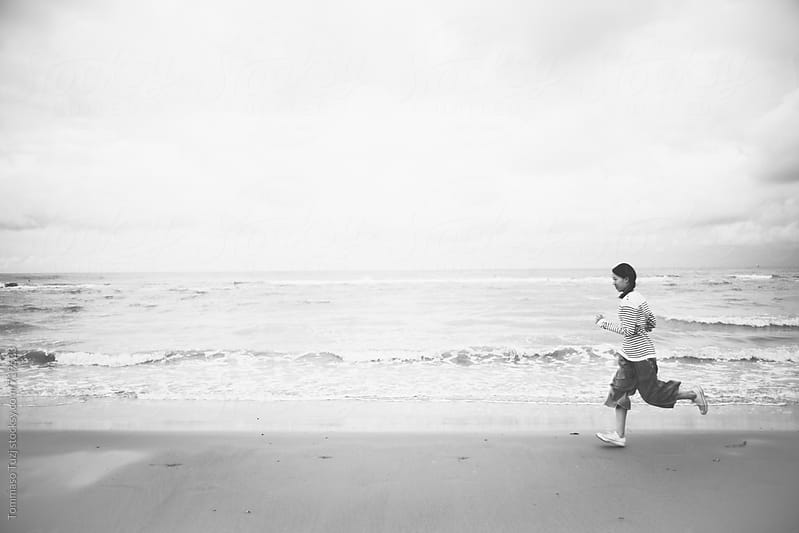 Running on the beach by Tommaso Tuzj for Stocksy United