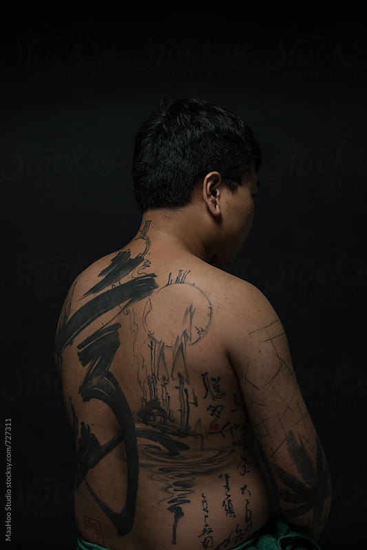 Rear view  of young man with tattooed upper body by Maa Hoo for Stocksy United