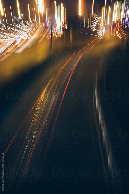 Car lights at night in Beijing, long exposure,motion blur by zheng long for Stocksy United