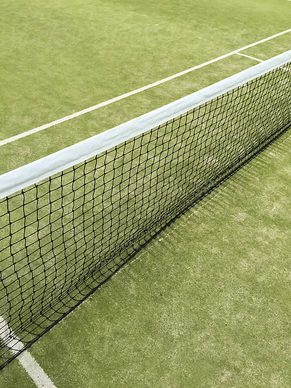 Empty paddle court, green carpet. no players are visible by Leandro Crespi for Stocksy United