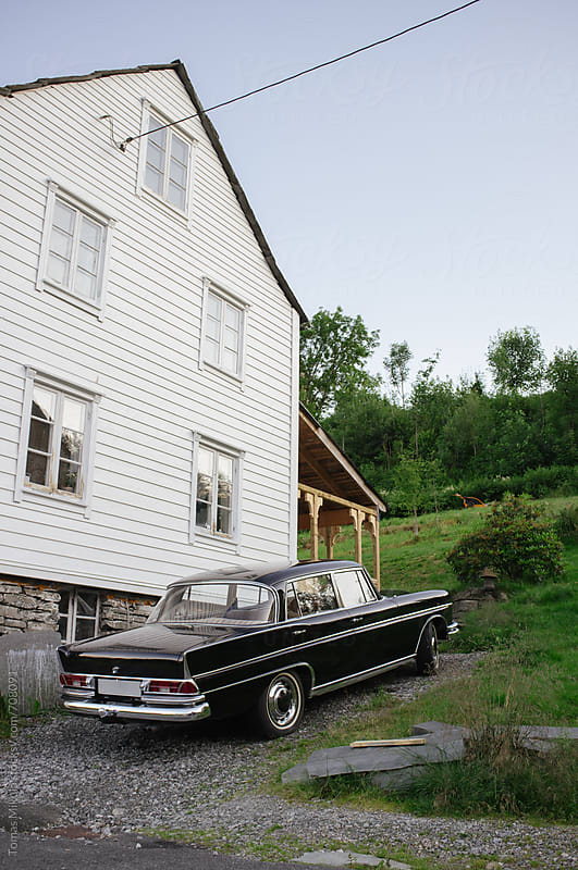 Old wooden house with vintage car by Tomas Mikula for Stocksy United