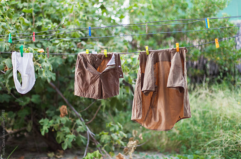 School Uniform Hanging on Laundry Line by Holly Clark for Stocksy United