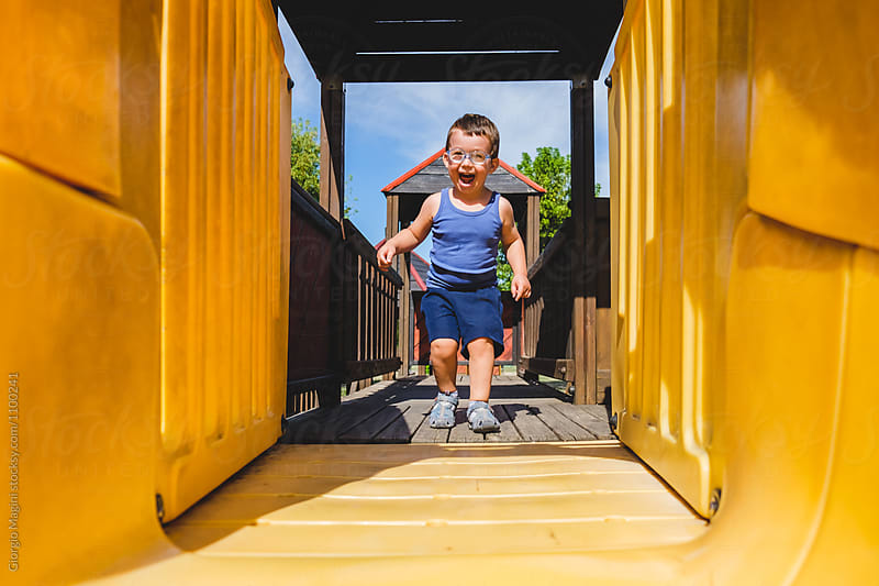 Toddler Boy Running at the Playground by Giorgio Magini for Stocksy United