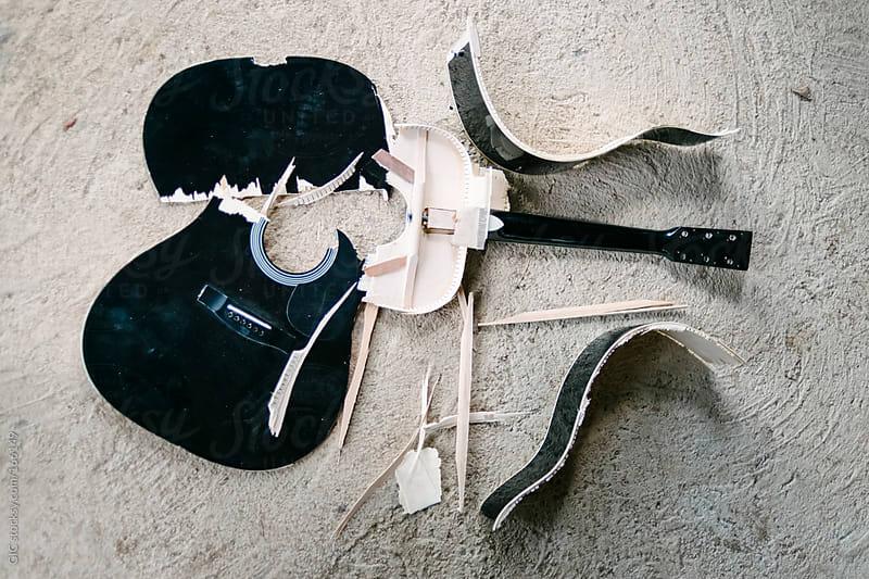 Broken guitar - overhead by GIC for Stocksy United