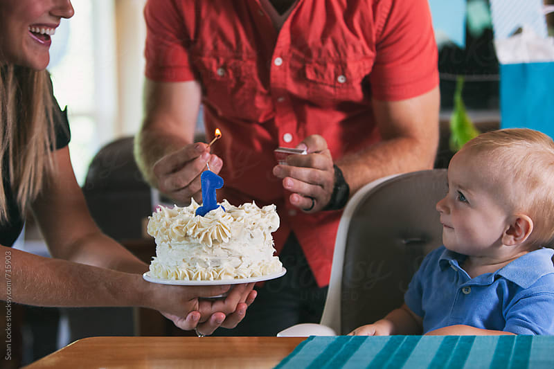 Birthday: Father Lighting Candle On Birthday Cake by Sean Locke for Stocksy United