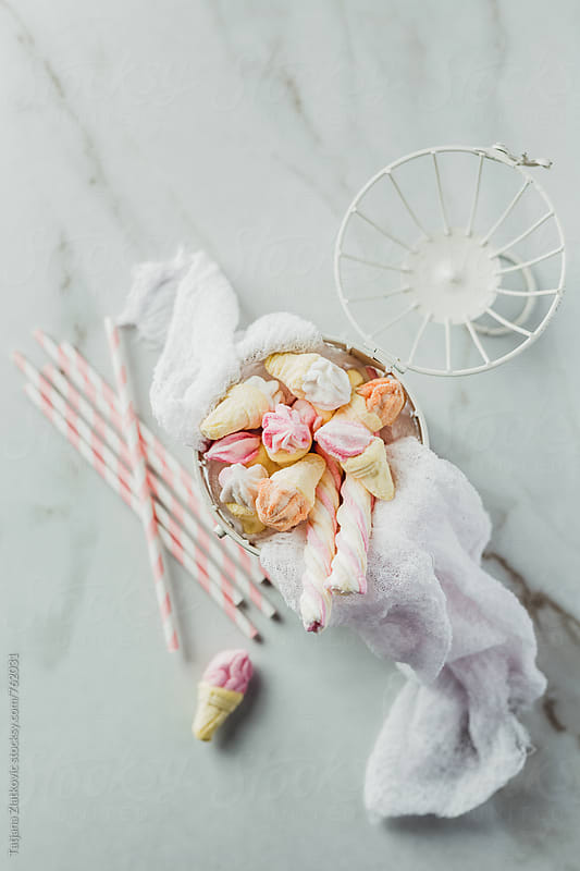 White vintage cage with marshmallows by Tatjana Zlatkovic for Stocksy United