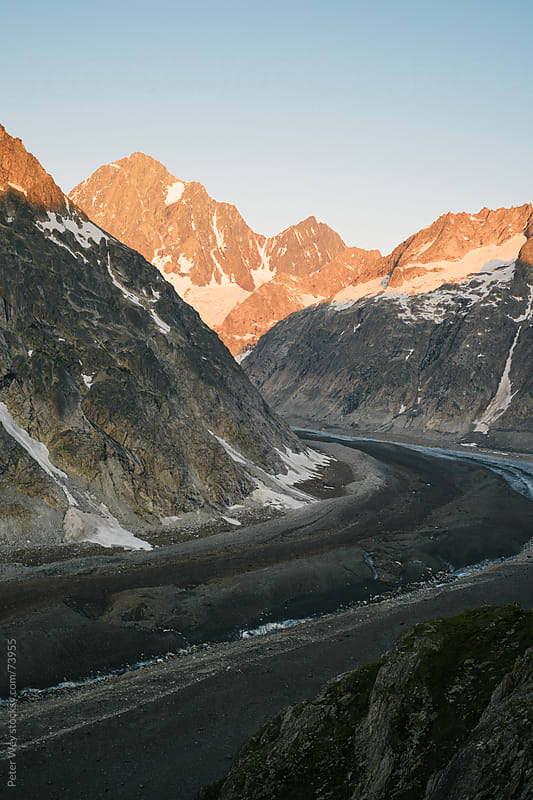 Finsteraarhorn mountain peak with Finsteraar glacier at sunrise by Peter Wey for Stocksy United