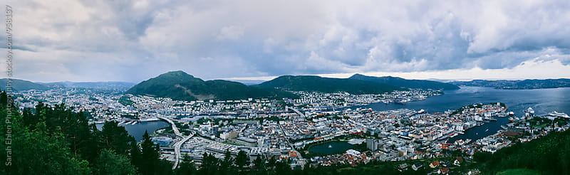 A panoramic view from Mount Floyen of Bergen and the Norwegian fjord region by Sarah Ehlen Photography for Stocksy United