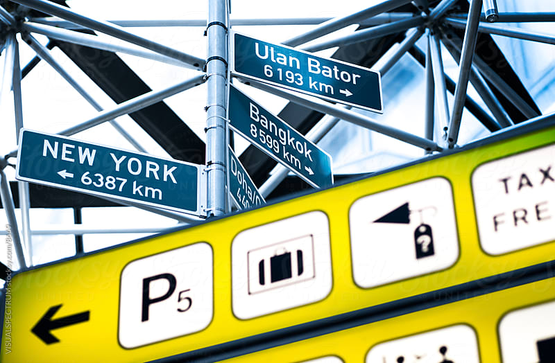 Crossroad And Sign Posts In Airport by VISUALSPECTRUM for Stocksy United