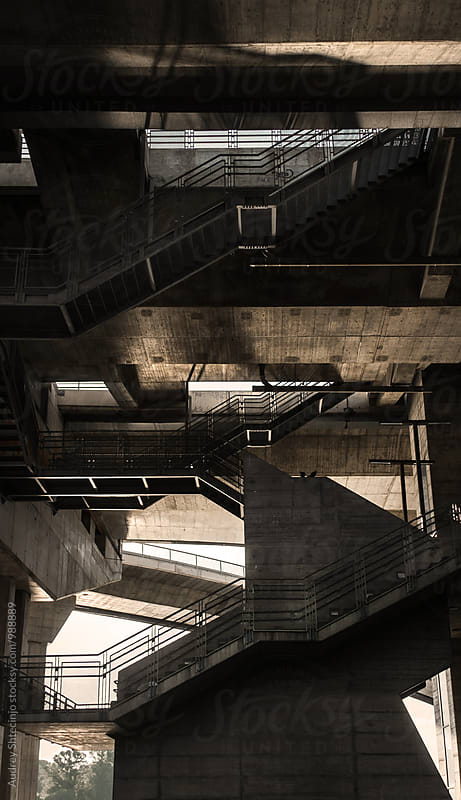 Complex public staircase under the bridge by Audrey Shtecinjo for Stocksy United