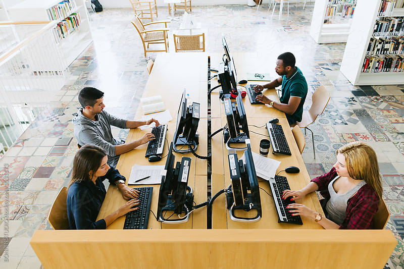 University students working in computer lab by BONNINSTUDIO for Stocksy United