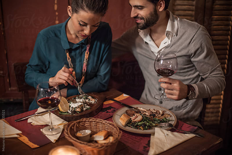 Happy Couple Having Dinner For Valentine's Day by Mosuno for Stocksy United