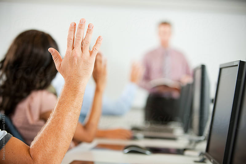 Computer Class: Male Student Raises Hand by Sean Locke for Stocksy United