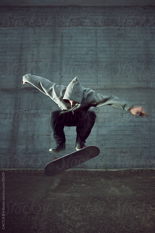 Guy doing a trick with his skate by CACTUS Blai Baules for Stocksy United