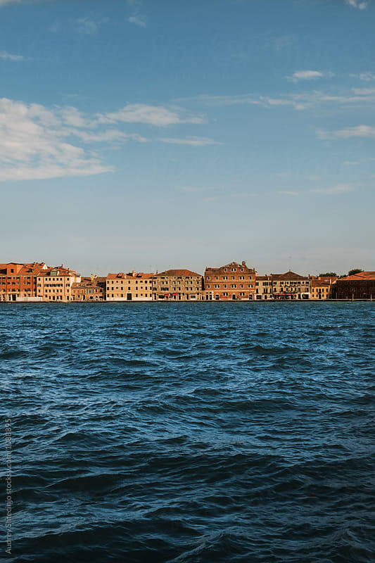 Look on Giudecca island locals houses with wavy sea.Venice/Italy by Audrey Shtecinjo for Stocksy United