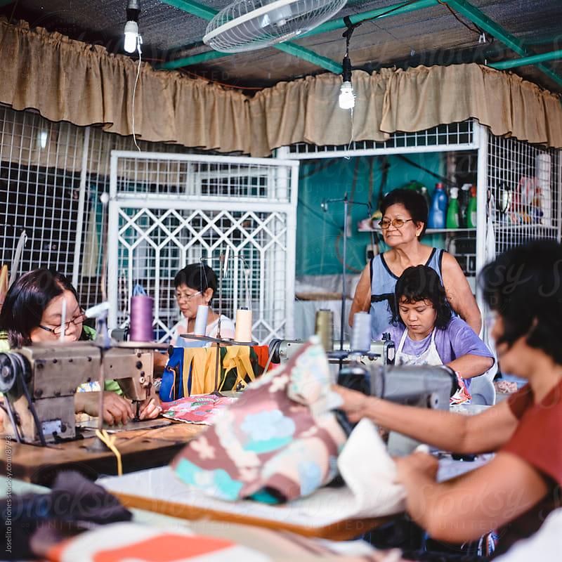 Neighborhood Co-op of Poor Women Making Craft by Joselito Briones for Stocksy United