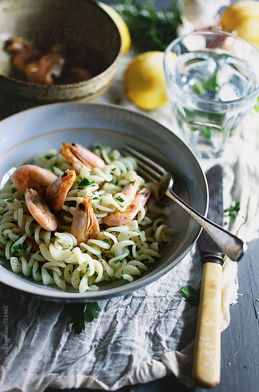 Fusilli pasta with shrimp and gremolata. by Darren Muir for Stocksy United