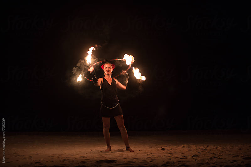 Woman Performing Fire Show on the Beach by Mosuno for Stocksy United
