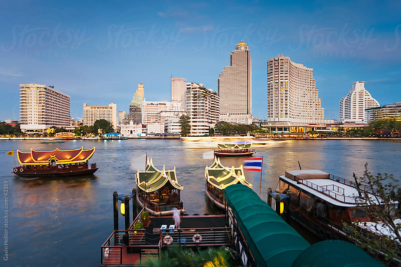 Chao Phraya river and the modern Bangkok skyline, Bangrak district, Bangkok, Thailand, South East Asia by Gavin Hellier for Stocksy United