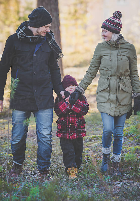autumn walk with the family by Andreas Gradin for Stocksy United