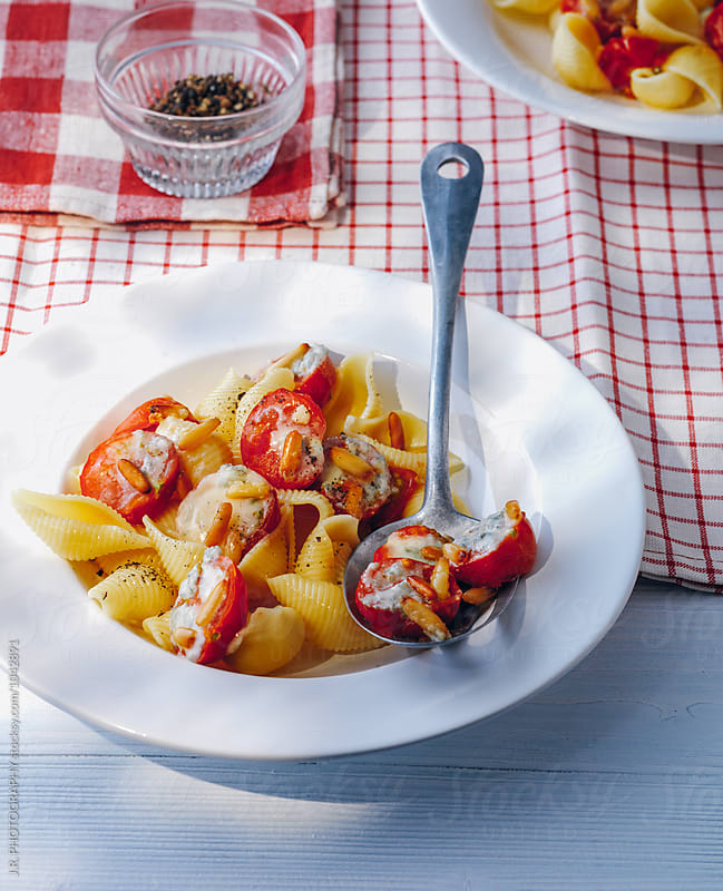Pasta shells with gorgonzola and tomato by J.R. PHOTOGRAPHY for Stocksy United