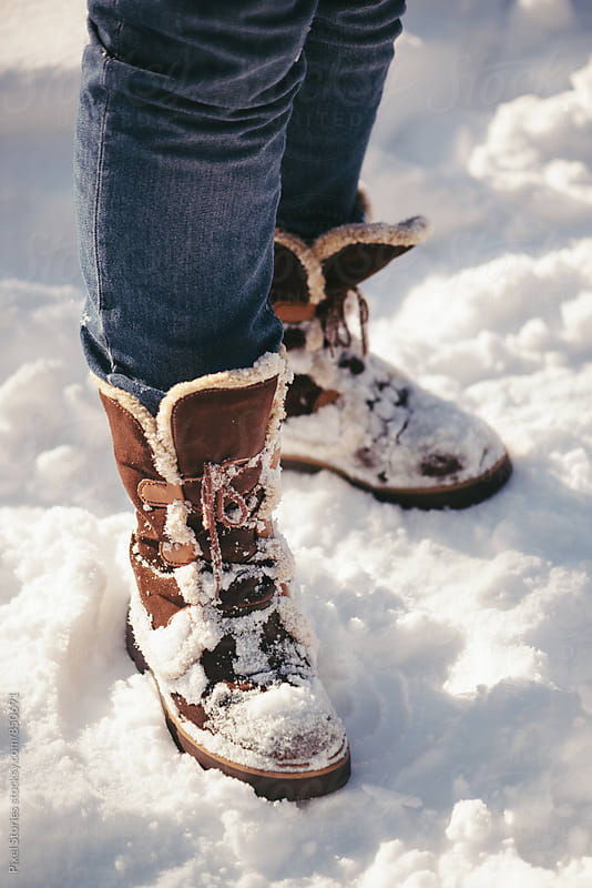 Snow-covered boots by Pixel Stories for Stocksy United