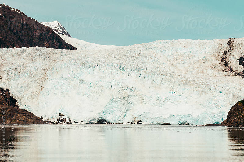 The Massive Icy Toe Of Coastal Holgate Glacier Meets The Ocean Waters Of Aialik Bay by Luke Mattson for Stocksy United